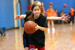 Young_girl_basketball_player_being_guarded