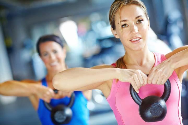 Women lifting kettlebell weights